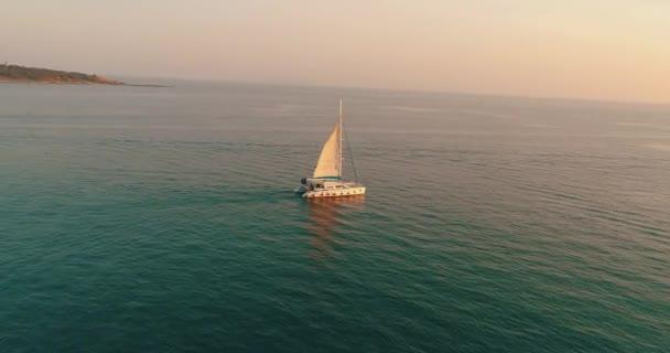 depositphotos_174204768-stock-video-yacht-sails-sea-sunset-drone.jpg