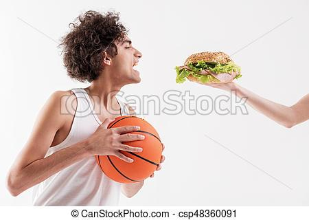 hungry-thin-young-man-holding-ball-stock-photograph_csp48360091.jpg